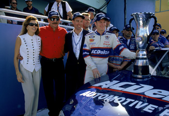HOMESTEAD, FL - NOVEMBER 13:  Dale Earnhardt Sr. (center left), owner of the Busch car, poses with driver Dale Earnhardt Jr. (far right) and Teresa Earnhardt after the win in the Hotwheels.com 300 at the Homestead Miami Speedway on November 13, 1999 in Ho