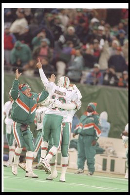 30 Nov 1994:  Quarterback Dan Marino of the Miami Dolphins celebrates during a game against the New York Jets at Giants Stadium in East Rutherford, New Jersey.  The Dolphins won the game, 28-24. Mandatory Credit: Simon Bruty  /Allsport