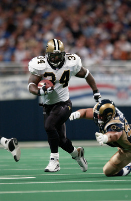 28 Oct 2001 : Ricky Williams #34 of the New Orleans Saints outruns a tackle by the St.Louis Rams during the game at the Dome at the America's Center in St.Louis, Missouri.  The Saints beat the Rams 34-31. DIGITAL IMAGE. Mandatory Credit: Elsa/Allsport
