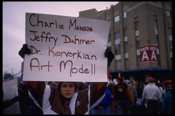 19 Nov 1995: Fans hold various signs which accuse Cleveland Browns owner Art Modell of disregard of fans which compares him to famous murderers at Cleveland Stadium in Cleveland, Ohio. The Packers defeated the Browns that day 31-20.