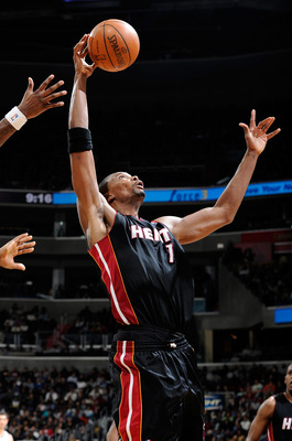 WASHINGTON, DC - DECEMBER 18:  Chris Bosh #1 of the Miami Heat grabs a rebound against the Washington Wizards at the Verizon Center on December 18, 2010 in Washington, DC. NOTE TO USER: User expressly acknowledges and agrees that, by downloading and or us