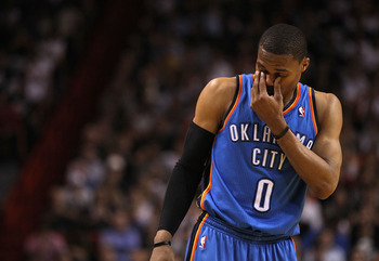 MIAMI, FL - MARCH 16:  Russell Westbrook #0 of the Oklahoma City Thunder rubs his eyes during a game against the Miami Heat at American Airlines Arena on March 16, 2011 in Miami, Florida. NOTE TO USER: User expressly acknowledges and agrees that, by downl
