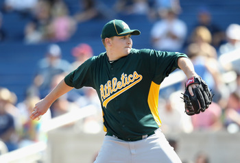 PHOENIX, AZ - MARCH 03:  Starting pitcher Trevor Cahill #53 of the Oakland Athletics pitches against the Milwaukee Brewers during the spring training game at Maryvale Baseball Park on March 3, 2011 in Phoenix, Arizona.  (Photo by Christian Petersen/Getty