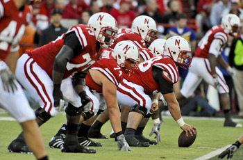 LINCOLN, NEBRASKA - SEPTEMBER 25: The Nebraska Cornhuskers offensive line, centered by offensive linesman Mike Caputo #58 lines up against the South Dakota State Jackrabbits during first half action of their game at Memorial Stadium on September 25, 2010