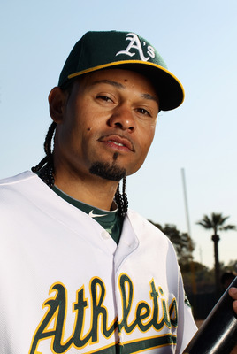PHOENIX, AZ - FEBRUARY 24:  Coco Crisp #4 of the Oakland Athletics poses for a portrait during media photo day at Phoenix Municipal Stadium on February 24, 2011 in Phoenix, Arizona.  (Photo by Ezra Shaw/Getty Images)