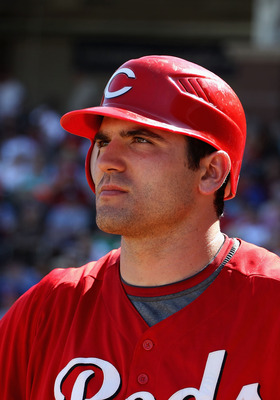 SURPRISE, AZ - MARCH 11:  Joey Votto #19 of the Cincinnati Reds waits to bat during the third inning of the spring training game against the Texas Rangers at Surprise Stadium on March 11, 2011 in Surprise, Arizona.  (Photo by Christian Petersen/Getty Imag