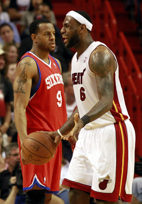 MIAMI, FL - MARCH 25:  LeBron James #6 of the Miami Heat reacts against Guard Andre Iguodala #9 of the Philadelphia Sixers at American Airlines Arena on March 25, 2011 in Miami, Florida. NOTE TO USER: User expressly acknowledges and agrees that, by downlo