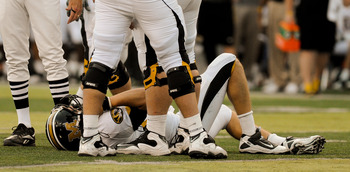 LINCOLN, NE - OCTOBER 30: Missouri Tigers quarterback Blaine Gabbert #11takes a moment after taking a hit from Courtney Osborne #12 of the Nebraska Cornhuskers during second half action of their game at Memorial Stadium on October 30, 2010 in Lincoln, Neb