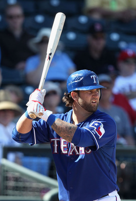 SURPRISE, AZ - MARCH 02:  Mike Napoli #25 of the Texas Rangers bats against the Los Angeles Angels of Anaheim during the spring training game at Surprise Stadium on March 2, 2011 in Surprise, Arizona.  (Photo by Christian Petersen/Getty Images)