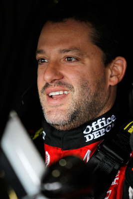 FONTANA, CA - MARCH 26:  Tony Stewart, driver of the #14 Office Depot/Mobil 1 Chevrolet, sits in his car during practice for the NASCAR Sprint Cup Series Auto Club 400 at Auto Club Speedway on March 26, 2011 in Fontana, California.  (Photo by Todd Warshaw