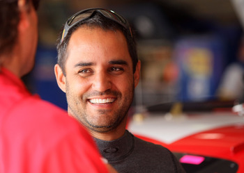 FONTANA, CA - MARCH 26:  Juan Pablo Montoya, driver of the #42 Target Chevrolet, stands in the garage area during practice for the NASCAR Sprint Cup Series Auto Club 400 at Auto Club Speedway on March 26, 2011 in Fontana, California.  (Photo by Victor Dec