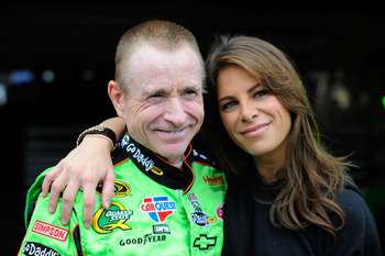 FONTANA, CA - MARCH 25:  Mark Martin, driver of the #5 GoDaddy.com Chevrolet, poses with celebrity fitness trainer Jillian Michaels prior to practice for the NASCAR Sprint Cup Series Auto Club 400 at Auto Club Speedway on March 25, 2011 in Fontana, Califo