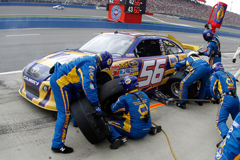 FONTANA, CA - MARCH 27:  Martin Truex Jr., driver of the #56 NAPA Toyota, makes a pit stop during the NASCAR Sprint Cup Series Auto Club 400 at Auto Club Speedway on March 27, 2011 in Fontana, California.  (Photo by Jason Smith/Getty Images for NASCAR)