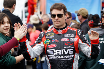 FONTANA, CA - MARCH 27:  Jeff Gordon, driver of the #24 Drive to End Hunger Chevrolet, greets fans during driver introductions for the NASCAR Sprint Cup Series Auto Club 400 at Auto Club Speedway on March 27, 2011 in Fontana, California.  (Photo by Todd W