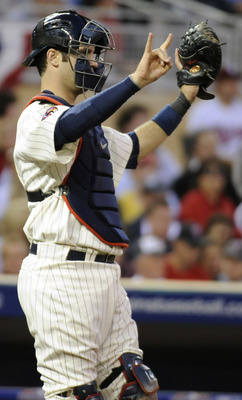 MINNEAPOLIS, MN - OCTOBER 7: Joe Mauer #7 of the Minnesota Twins gives signs during game two of the ALDS game against the New York Yankees on October 7, 2010 at Target Field in Minneapolis, Minnesota.  (Photo by Hannah Foslien/Getty Images)