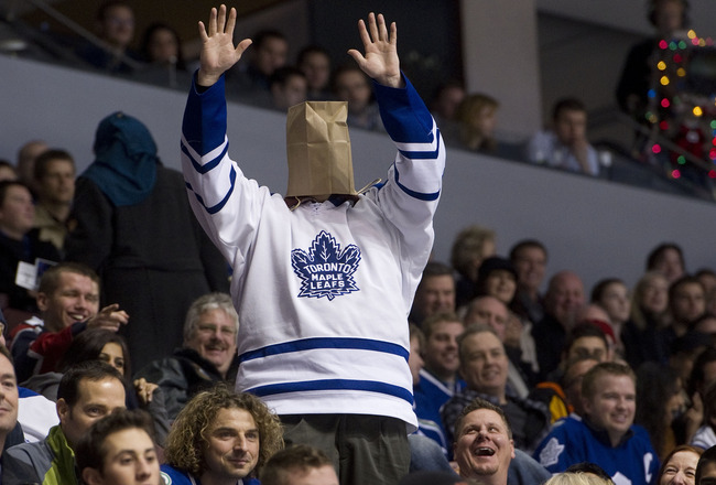 VANCOUVER, CANADA - DECEMBER 18: A Toronto Maple Leafs fans cheers during the late stages of the third period in NHL action on December 18, 2010 between the Vancouver Canucks and the Maple Leafs at Rogers Arena in Vancouver, BC, Canada.  (Photo by Rich La