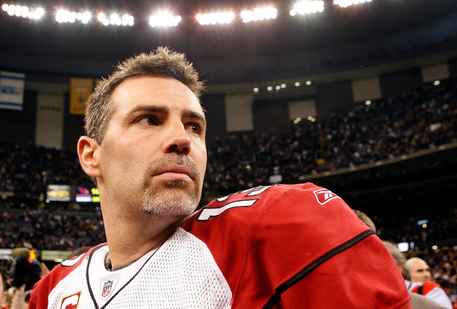 NEW ORLEANS - JANUARY 16:  Quarterback Kurt Warner #13 of the Arizona Cardinals looks on as he stands on the field after their 45-14 loss against the New Orleans Saints during the NFC Divisional Playoff Game at Louisana Superdome on January 16, 2010 in Ne