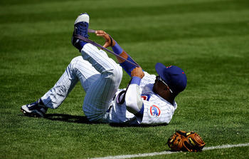 MESA, AZ - MARCH 09:  Starlin Castro #13 of the Chicago Cubs stretches during batting practice before the spring training baseball game against the Kansas City Royals at HoHoKam Stadium on March 9, 2011 in Mesa, Arizona.  (Photo by Kevork Djansezian/Getty