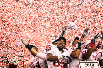 ARLINGTON, TX - DECEMBER 04:  Wide receiver Ryan Broyles #85 of the Oklahoma Sooners celebrates a 23-20 win against the Nebraska Cornhuskers during the Big 12 Championship at Cowboys Stadium on December 4, 2010 in Arlington, Texas.  (Photo by Ronald Marti