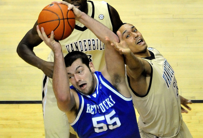 NASHVILLE, TN - FEBRUARY 12:  Josh Harrelson #55 of the Kentucky Wildcats takes a rebound away from John Jenkins #23 of the Vanderbilt Commodores at Memorial Gym on February 12, 2011 in Nashville, Tennessee.  (Photo by Grant Halverson/Getty Images)