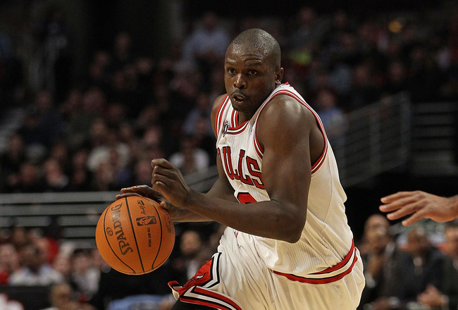 CHICAGO, IL - MARCH 25: Loul  Deng #9 of the Chicago Bulls drives against the Memphis Grizzlies at the United Center on March 25, 2011 in Chicago, Illinois. The Bulls defeated the Grizzlies 99-96. NOTE TO USER: User expressly acknowledges and agrees that,