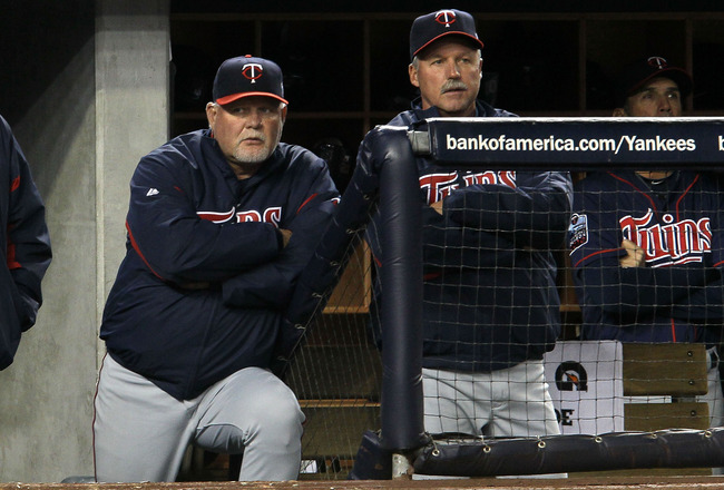 NEW YORK - OCTOBER 09:  Manager Ron Gardenhire (L) #35 of the Minnesota Twins looks on from the dugout late in the game against the New York Yankees  during Game Three of the ALDS part of the 2010 MLB Playoffs at Yankee Stadium on October 9, 2010 in the B