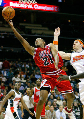 CHARLOTTE, NC - DECEMBER 05:  Chris Duhon #21 of the Chicago Bulls lays in a basket past Walter Herrmann #5 of the Charlotte Bobcats during the second half at Bobcats Arena on December 5, 2007 in Charlotte, North Carolina.  Chicago defeated Charlotte 91-8