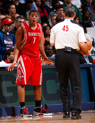 ATLANTA - NOVEMBER 20:  Kyle Lowry #7 of the Houston Rockets converses with referee Joe Forte #45 during the game against the Atlanta Hawks at Philips Arena on November 20, 2009 in Atlanta, Georgia.  NOTE TO USER: User expressly acknowledges and agrees th