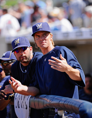 PHOENIX, AZ - MARCH 10:  Pitchers Zack Greinke #13 and Shaun Marcum #18  of the Milwaukee Brewers look at fans during the spring teaining baseball agme against Colorado Rockies at Maryvale Baseball Park on March 10, 2011 in Phoenix, Arizona.  (Photo by Ke