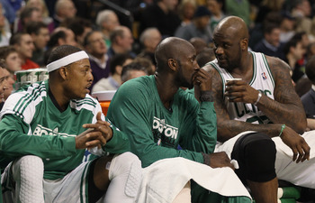 BOSTON, MA - JANUARY 17:  Paul Pierce #34, Kevin Garnett #5 and Shaquille O'Neal #36 of the Boston Celtics talk on the bench in the first quarter against the Orlando Magic on January 17, 2011 at the TD Garden in Boston, Massachusetts.  NOTE TO USER: User