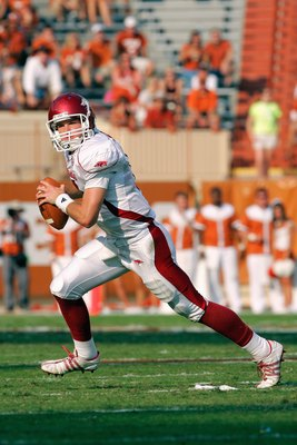 AUSTIN, TX - SEPTEMBER 27:  Quarterback Tyler Wilson #8 of the Arkansas Razorbacks moves to pass the ball during the game against the Texas Longhorns on September 27, 2008 at Darrell K Royal-Texas Memorial Stadium in Austin, Texas.  Texas won 52-10.  (Pho