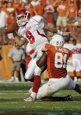 AUSTIN, TX - SEPTEMBER 27:  Defensive end Sam Acho #81 of the Texas Longhorns sacks quarterback Tyler Wilson #8 of the Arkansas Razorbacks on September 27, 2008 at Darrell K Royal-Texas Memorial Stadium in Austin, Texas.  (Photo by Brian Bahr/Getty Images