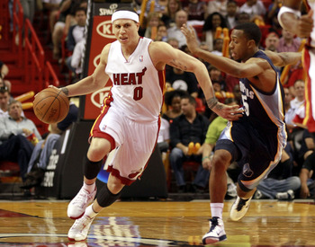 MIAMI - MARCH 12:  Guard Mike Bibby #0 of the Miami Heat (L) drives the ball against Guard Ishmael Smith #5 of the Memphis Grizzlies at American Airlines Arena on March 12, 2011 in Miami, Florida. NOTE TO USER: User expressly acknowledges and agrees that,
