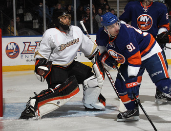 UNIONDALE, NY - DECEMBER 16:  Jonas Hiller #1 of the Anaheim Ducks tends net against John Tavares #91 of the New York Islanders the New York Islanders at the Nassau Coliseum on December 16, 2010 in Uniondale, New York.  (Photo by Bruce Bennett/Getty Image