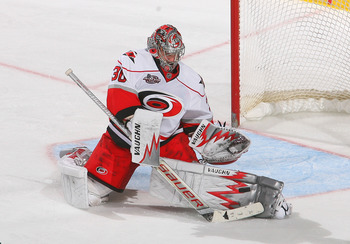 BUFFALO, NY - MARCH 15: Cam Ward #30 of Carolina Hurricanes makes a save against the Buffalo Sabres  at HSBC Arena on March 15, 2011 in Buffalo, New York. Carolina won 1-0. (Photo by Rick Stewart/Getty Images)