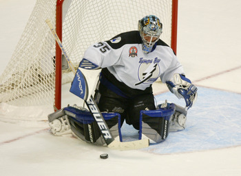 CALGARY, CANADA - JUNE 5:  Nikolai Khabibulin #35 of the Tampa Bay Lightning makes a save as he eyes the puck against the Calgary Flames in Game six of the NHL Stanley Cup Finals on June 5, 2004 at Pengrowth Saddledome in Calgary, Canada.  The Lightning d