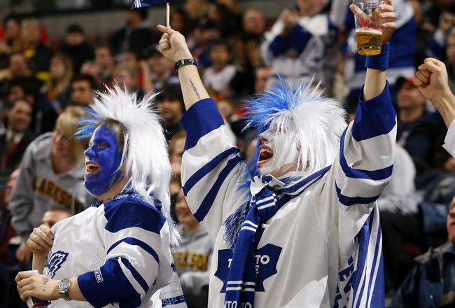 OTTAWA, ON - NOVEMBER 17:  Two lively fans of the Toronto Maple Leafs celebrate a goal against the Ottawa Senators in a game at Scotiabank Place on November 17, 2009 in Ottawa, Canada. (Photo by Phillip MacCallum/Getty Images)