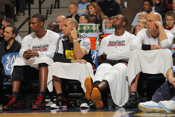 DENVER, CO - JANUARY 13:  (L-R) Chris Bosh #1, Carlos Arroyo #8, Dwayne Wade #3 and Zydrunas Ilgaukas #11 of the Miami Heat sit on the bench in the fourth quarter against the Denver Nuggets at the Pepsi Center on January 13, 2011 in Denver, Colorado. The
