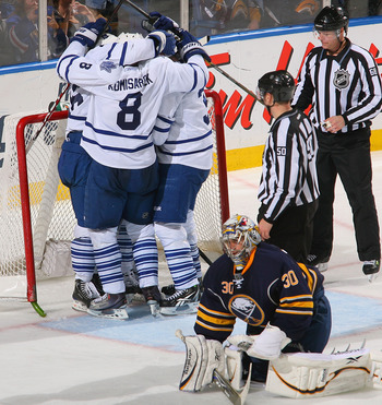 BUFFALO, NY - FEBRUARY 16: Mike Komisarek #8, Dion Phaneuf #3, Tim Brent #37 and Joey Crabb #46 celebrate Crabb's game winning goal behind Ryan Miller #30  of the Buffalo Sabres the Toronto Maple Leafs at HSBC Arena on February 16, 2011 in Buffalo, New Yo