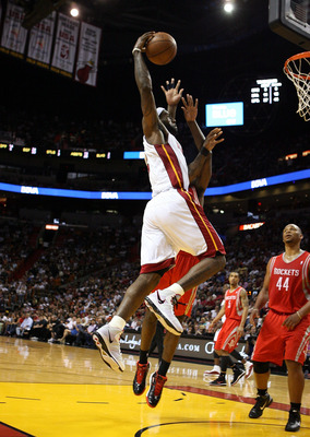 MIAMI, FL - MARCH 27:  Forward LeBron James #6 of the Miami Heat dunks against the Houston Rockets at American Airlines Arena on March 27, 2011 in Miami, Florida. The Heat defeated the Rockets 125-119. NOTE TO USER: User expressly acknowledges and agrees