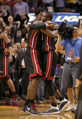 MIAMI, FL - MARCH 10:  Dwyane Wade #3 and LeBron James #6 of the Miami Heat hug after winning a game against  the Los Angeles Lakers at American Airlines Arena on March 10, 2011 in Miami, Florida. NOTE TO USER: User expressly acknowledges and agrees that,
