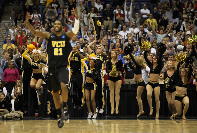 SAN ANTONIO, TX - MARCH 25:  Jamie Skeen #21 of the Virginia Commonwealth Rams and the VCU fans celebrate after defeating the Florida State Seminoles during the southwest regional of the 2011 NCAA men's basketball tournament at the Alamodome on March 25,