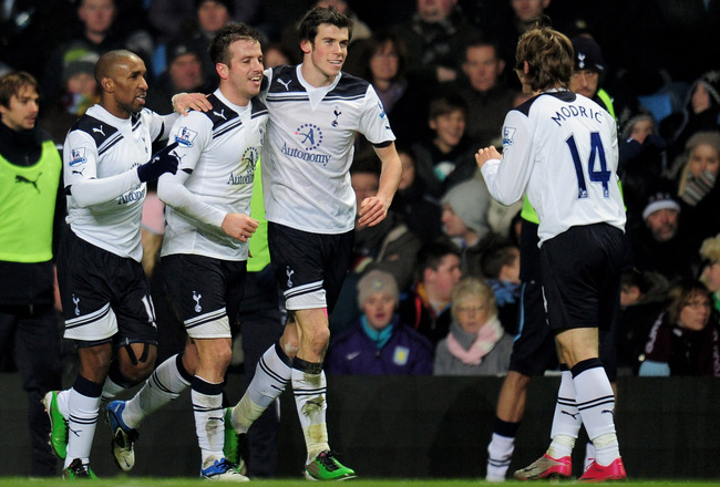 BIRMINGHAM, ENGLAND - DECEMBER 26:  (L-R) Jermaine Defoe, Rafael Van Der Vaart, Gareth Bale and Luka Modric of Tottenham celebrate after Van Der Vaart scores the opening goal during the Barclays Premier League match between Aston Villa and Tottenham Hotsp