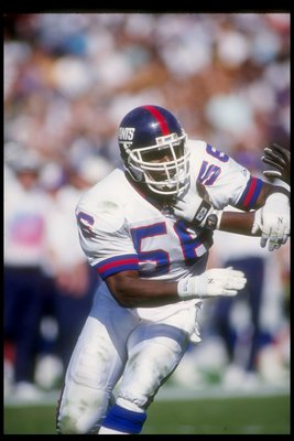4 Oct 1992:  Linebacker Lawrence Taylor of the New York Giants works against the Los Angeles Raiders during a game at the Los Angeles Memorial Coliseum in Los Angeles, California.  The Raiders won the game, 13-10. Mandatory Credit: Ken Levine  /Allsport
