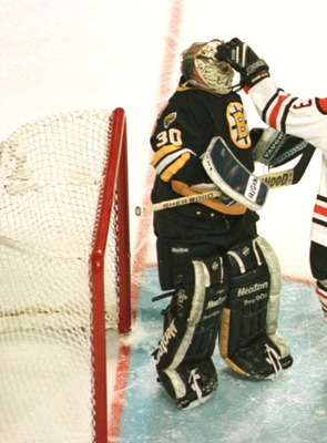 19 Jan 1996:  Lanny McDonald #9 of the NHL Heroes gives a friendly pat to the mask of goalie Gerry Cheevers #30 of the Boston Bruins Heroes during the first period of the NHL Heroes of Hockey game played at the Fleet Center in Boston, Massachusetts. Manda