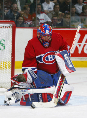 MONTREAL - APRIL 29:  Jose Theodore #60 of the Montreal Canadiens makes a stick save against the Tampa Bay Lightning during game four of the eastern conference semifinals on April 29, 2004 at the Bell Centre in Montreal, Quebec.  The Lightning defeated th