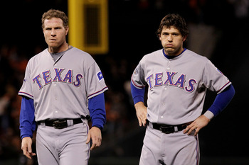 SAN FRANCISCO - OCTOBER 28:  (L-R) Josh Hamilton #32 and Ian Kinsler #5 of the Texas Rangers look on after the end of the top of the sixth inning while taking on the San Francisco Giants in Game Two of the 2010 MLB World Series at AT&T Park on October 28,