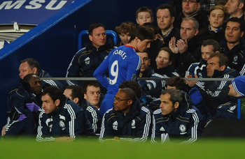 LONDON, ENGLAND - FEBRUARY 06:  Fernando Torres of Chelsea takes a seat on the bench as he is substituted during the Barclays Premier League match between Chelsea and Liverpool at Stamford Bridge on February 6, 2011 in London, England.  (Photo by Laurence