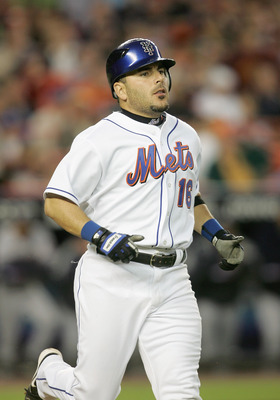 FLUSHING, NY - MAY 1:  Paul Lo Duca #16 of the New York Mets runs during the game against the Washington Nationals on May 1, 2006 at Shea Stadium in the Flushing, neighborhood of the Queens borough of New York City. (Photo by Nick Laham/Getty Images)