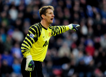 WIGAN, ENGLAND - FEBRUARY 26:  Edwin van der Sar of Manchester United gestures during the Barclays Premier League match between Wigan Athletic and Manchester United at the DW Stadium on February 26, 2011 in Wigan, England.  (Photo by Jamie McDonald/Getty